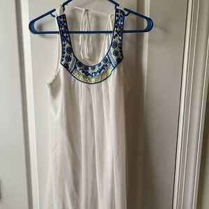 white dress with a detailed blue and yellow top